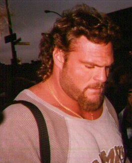 kane with hair and a beard